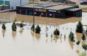 image of building in Medicine Hat surrunded by flood waters