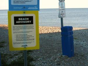 image of sign warning of water quality problems on beach