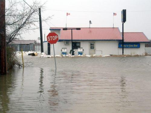 image of small store surrounded by water in flood