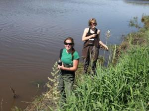 image of 2 women taking water samples from the creek