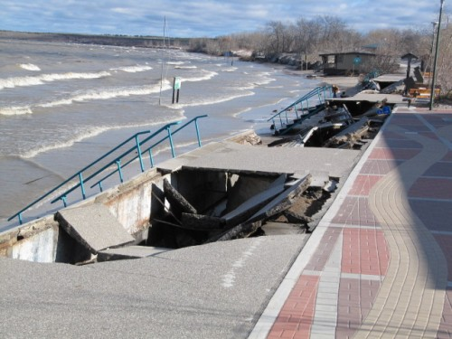 image of collapsed sections of baordwalk along a beach