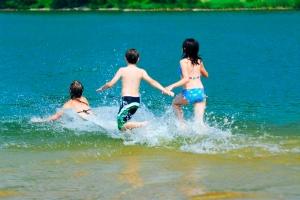 image of 3 children splashing in water