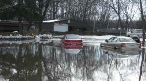 image of car flooded in front of house