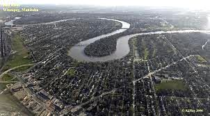 aerial image of Red River flowing through city of Winnipeg