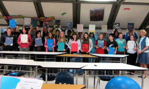 Grade 8 Calss with Saving Lake Winnipeg books, Tanner's Crossing School